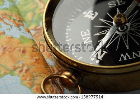 Compass on Earth map background