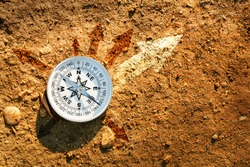 compass on earth with arrows, Find the best way concept, flat top view