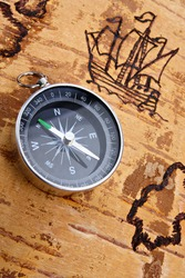 Compass on marine chart on the order of olden time