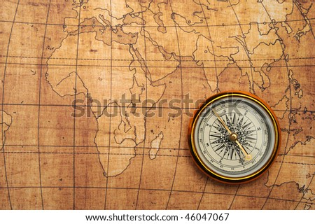compass on old map. gold...