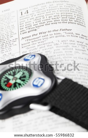 Compass on open Bible with focus on the text in John 14 about Jesus being the way to God