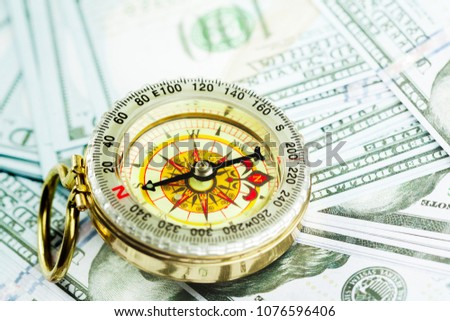 compass on pile of US money