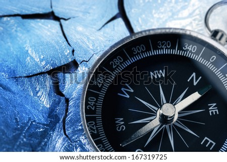 Compass on racked piece of old wall in icy style