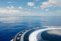 Compass on ship boat blue summer sea ocean day with bright sky. Marine navigation cruise background banner. Shipping industry concept.
