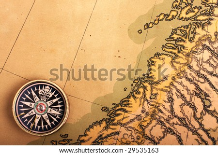 Compass on the ancient map