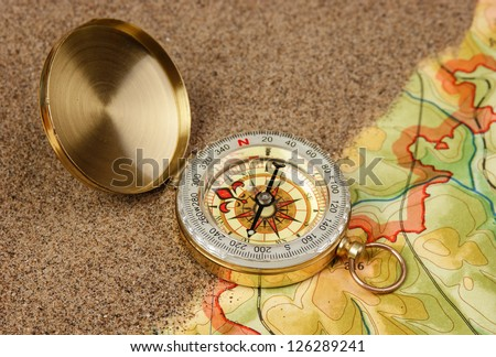 compass on the map with sand