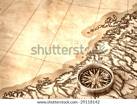 Compass on the old map
