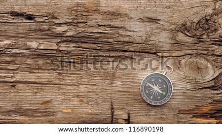 compass on the old wooden...