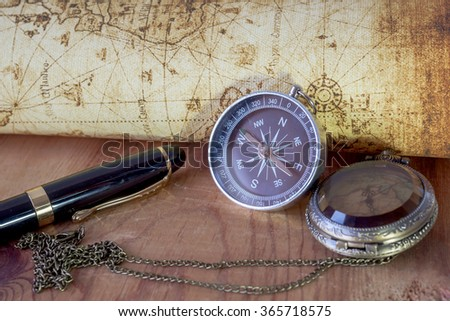 Compass on vintage map. Retro style. #365718575
