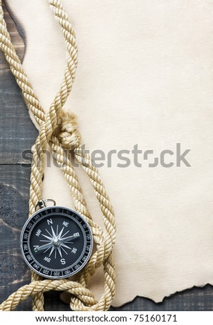 Compass on vintage paper background