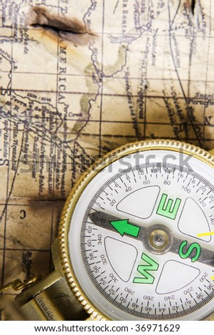 Compass over old map background