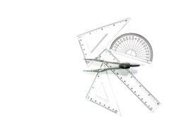 Compass set ,Half circle , Triangular ruler, ruler, and roundabout. Construction equipment on a white floor.