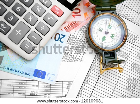 Compass, the calculator and euro on documents.