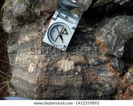 Compass (type: Clar) on the rock, Varre-sai RJ - Brazil Stock fotó ©