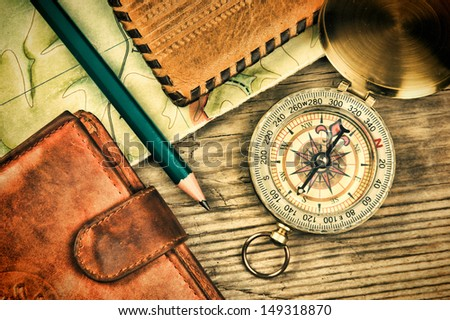 compass wallet and passport on a wooden table #149318870