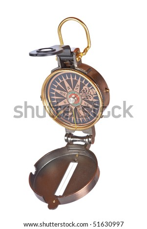 Compass with focus on the south over a white background. Shallow depth of field
