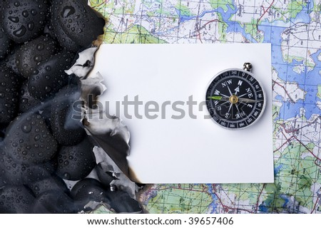 Compass with rock cover water