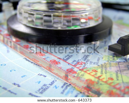 compass  with ruler on a map of the americas. shallow depth of field.