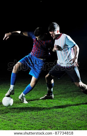competition Action run and jump Duel of football players at soccer ball stadium at night