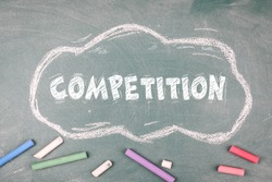 Competition. Business education and science concept, green chalk board