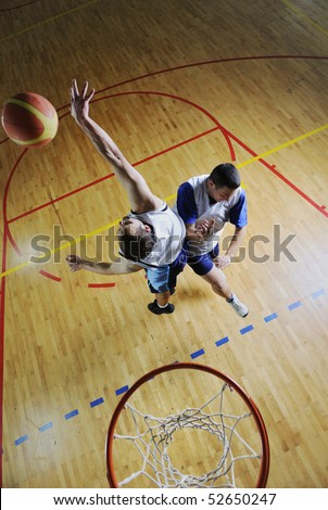 competition concept with people who playing and exercise  basketball sport  in school gym