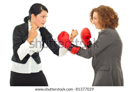Competition  fight two business women ,one of them wearing boxing gloves isolated on white background