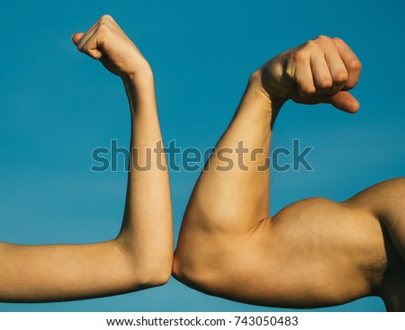 Competition, strength comparison. Vs. Fight hard. Health concept. Hand, man arm, fist. Musclar arm vs weak hand.