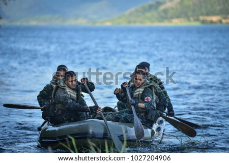 Competitions and test the strength Competing in a rubber boat at a designated time of the military of Fort Thanarat, at Pranburi Dam Prachuap Khiri Khan Province in Thailand on December 17, 2017   #1027204906