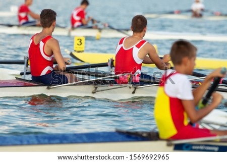 Competitions in rowing. Scullers in Competition. #1569692965
