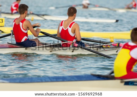 Competitions in rowing. Scullers in Competition. #1569692968