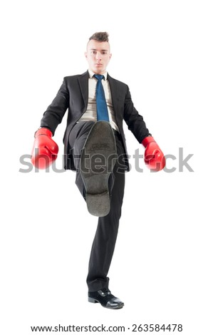 Competitive and aggresive business man tread over the competitors concept on white background #263584478