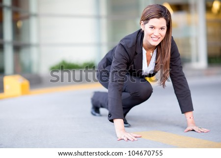 Competitive business woman in a racing position