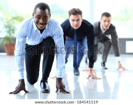 Competitive businessmen ready to start running. Concept of leadership and success