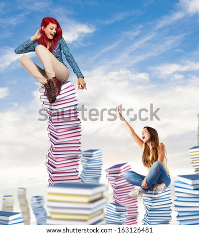 competitive young woman sitting on a books pile ascending to the sky #163126481