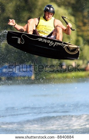 Competitor in mid air at a wake boarding competition.