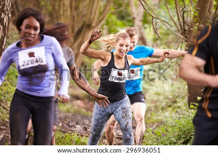 Competitors enjoying a run in a forest at an endurance event
