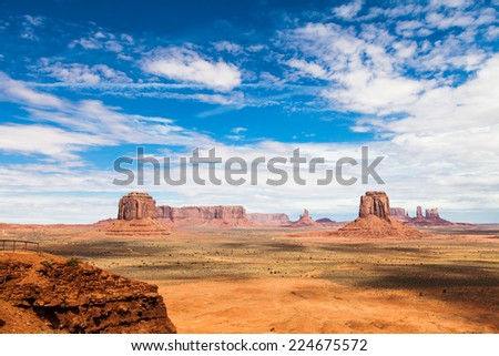 Complementary colours blue and orange in this iconic view of Monument Valley, USA #224675572