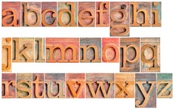 complete English lowercase alphabet - a high resolution collage of 26 isolated vintage wood letterpress printing blocks, stained by color inks