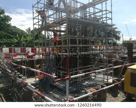 Complete scaffold with netting and Green tag approval for access used for construction of R.C column. Image contain excessive noise, film grain, compression artifacts and posterization. Photo stock ©