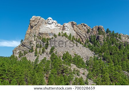 Complete wide angle view of Mount Rushmore national monument with the surrounding forest and nature near Rapid City in South Dakota, United States of America, USA.