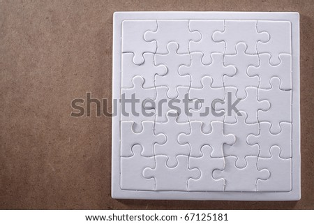 Completed jigsaw puzzle isolated on a wooden table.