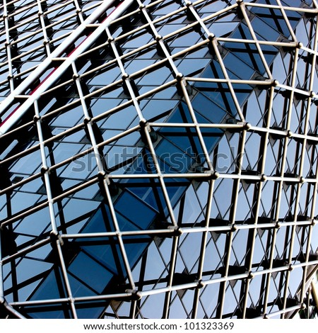 Complex building structural detail, blue metal bars and glass