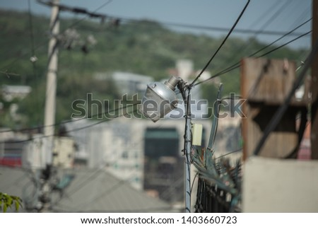 Complex wires are gathering to a pole. The complexity of the city. #1403660723