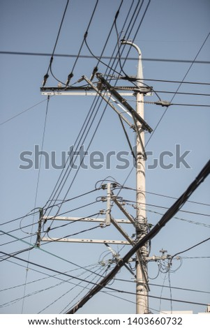 Complex wires are gathering to a pole. The complexity of the city. #1403660732