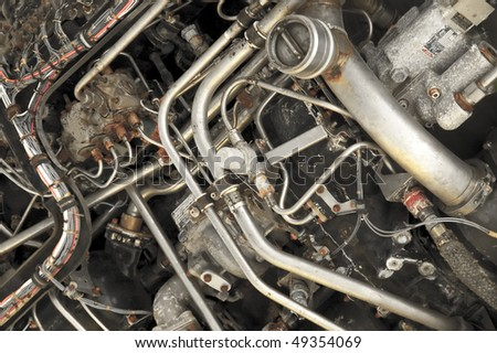 complex workings of an old aircraft jet engine - stock photo