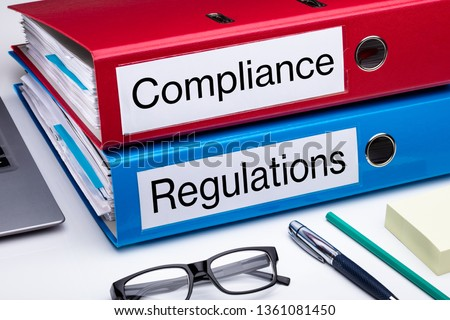 Compliance And Regulation With Office Supplies Over Business Desk Stock photo ©