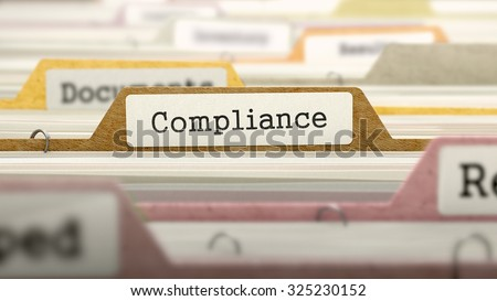 Compliance Concept on Folder Register in Multicolor Card Index. Closeup View. Selective Focus.