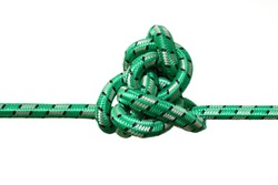 complicated knot on a green rope