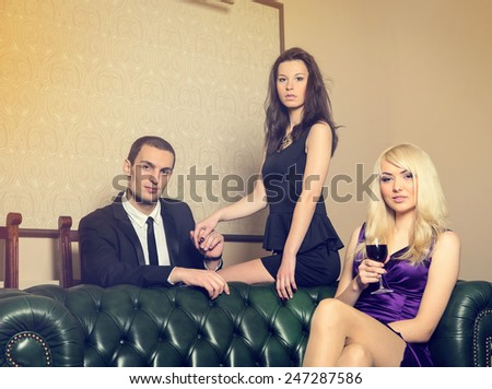 Complicated love relationship between three people. At party at the club. One man and two women - love triangle. She saw her man with another woman and jealous. Cheating husband cheating on his wife.