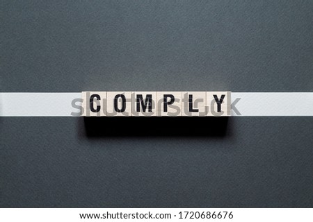 Comply word concept on cubes Stock photo ©